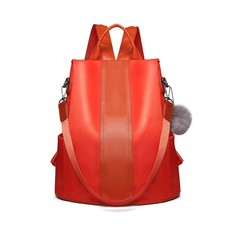Batoh - elegantný cez rameno s pompom príveskom, oranžový